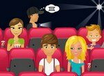 Парочка целуется в кинотеатре